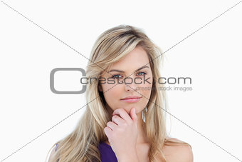 Serious blonde woman looking at the camera