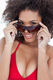 Attractive brunette holding her sunglasses while smiling
