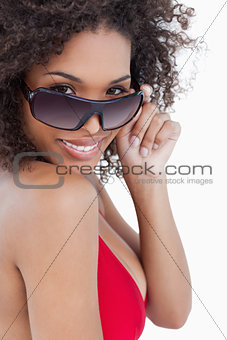 Smiling woman looking over her sunglasses