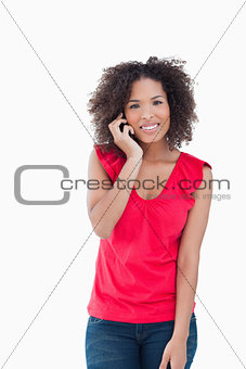 Smiling woman looking at the camera while calling