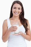 Smiling woman holding a glass of milk