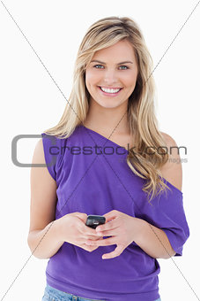 Smiling blonde woman looking at the camera while holding her mob