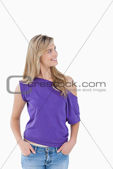 Smiling blonde woman looking away