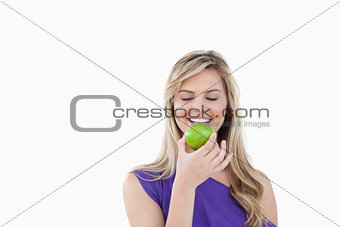 Smiling woman holding a delicious apple