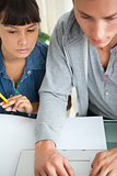 Close-up of two students doing homework