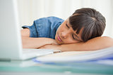 Female student sleeping on her desk