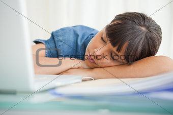Female student sleeping on her desk