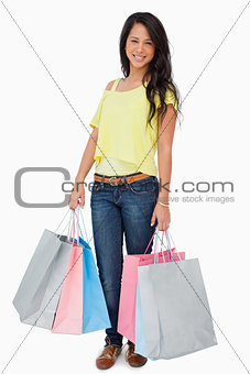 Beautiful Latin student with shopping bags