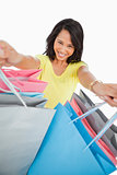 High-angle view of a young woman showing shopping bags
