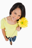 High-angle view of a Latino woman holding a flower