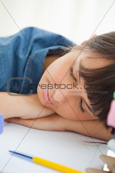 Close-up of a female student sleeping among her books