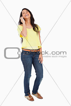 Beautiful Latin student laughing on the phone