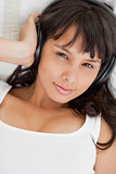 Portrait of a beautiful student listening to music