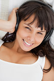 Portrait of a smiling student listening to music
