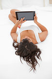 Rear view of a young woman using a touch pad