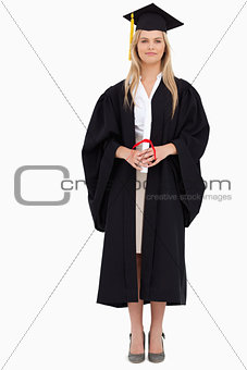 Blonde student in graduate robe