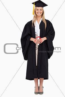 Smiling blonde student in graduate robe