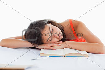 Sleeping student head on her books