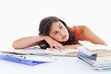 Bored female student doing her homework