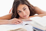 Portrait of a beautiful brunette head on her homeworks