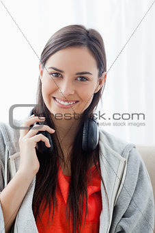 Close up shot of a woman with headphones looking into the camera