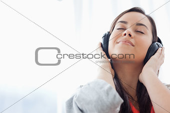 A peaceful woman listening to music on her headphones