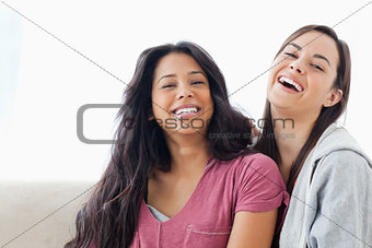 Two laughing women looking towards the camer