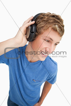 Fisheye view of a blond man wearing headphones