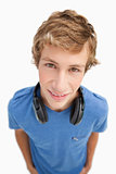 Fisheye view of a blond man with headphones