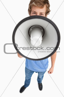 Fisheye view of a male student speaking in a megaphone