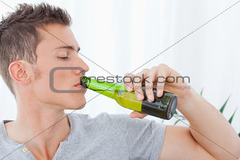 A handsome man drinking some beer