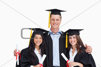 Three friends graduate from college together