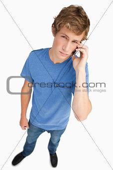 Fisheye view of a young man calling