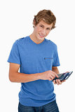 Portrait of a young man using a calculator