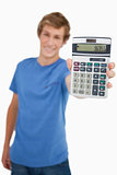 Young man showing a calculator