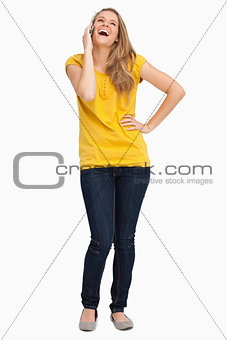 Beautiful blonde woman laughing on the phone