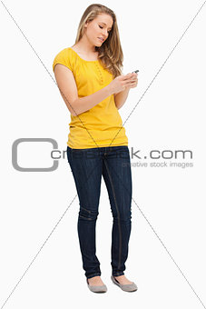 Attractive blonde woman using her cellphone