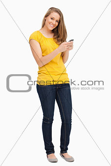 Attractive blonde woman posing while using her cellphone