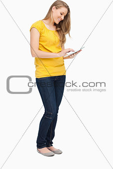 Blonde woman smiling while using a touch pad