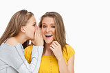 Blonde student whispering to a friend