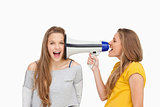 Blonde student using a loudspeaker on her friend