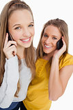 Close-up of two students smiling on the phone