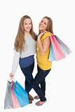 Two beautiful young women holding shopping bags
