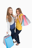 Two beautiful young women with shopping bags the thumb-up