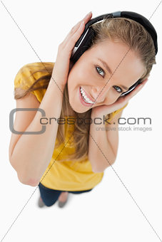 Fisheye view of a blonde girl wearing a headphones