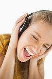 Close-up of a blonde woman enjoying music with headphones