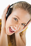 Close-up of a blonde student enjoying music with headphones