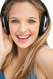 Portrait of a beautiful young blonde wearing headphones