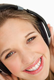 Close-up of a green-eyes woman listening to music