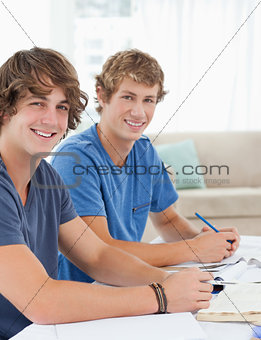 Close up of two smiling students looking into the camera